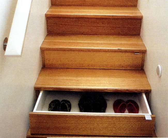 I like this idea... drawers under the stairs!