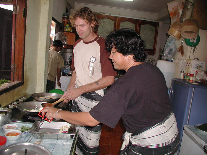 Taking cooking lessons in Laos, summer 2002.