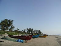 Small fishing boats on Arambol beach, northern Goa.