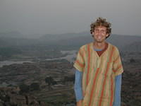 Yours truly, cold yet happy in the early morning dawn. In Hampi.