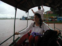 Nancy's excitement as we take a boat to cross the Thai border into northern Laos, also near the Chinese border.