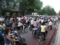 Typical street in Hanoi. Almost all two-wheelers. I was on a bicycle myself --> but I flew down those streets faster than if